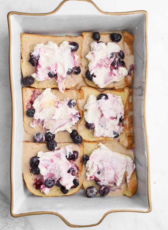 A picture of blueberry cream cheese french toast in a pan
