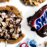 These cute chewy 5 Ingredient Pillsbury Chocolate Chip Snicker Pretzel Cookie Pops were so fun to make! Not to mention super easy! Perfect for a party, cookout bake sale or gift!