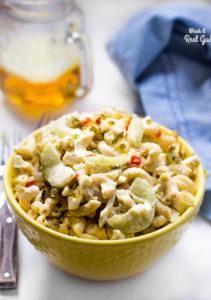 Creamy macaroni salad with cucumbers and eggs