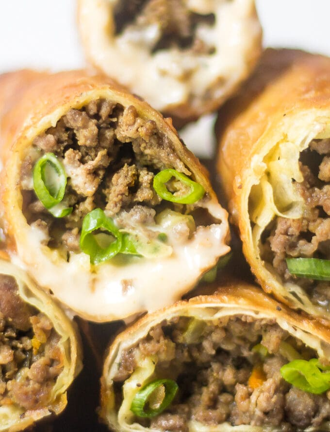 Crunchy on the outside and savory aromatic meat filling on the inside. These Middle Eastern Sambousek Egg Rolls are bursting with flavor. Perfect hand food for game day!