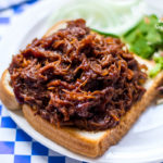 Tender, juicy, saucy, tangy, flavorful and easy Slow Cooker Beef BBQ Sandwich!