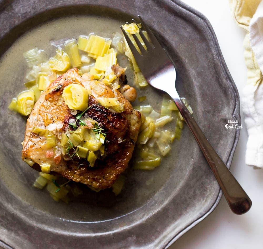 braised cider chicken on plate with leek sauce