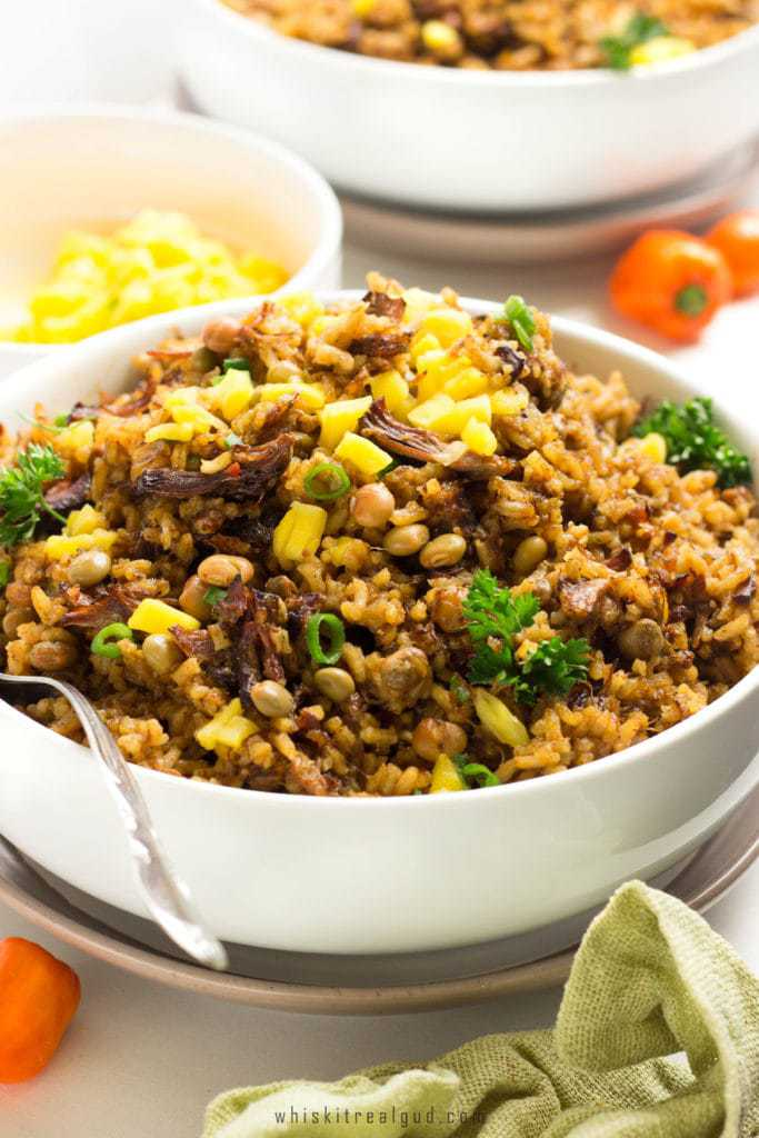 Trinidad Oxtail Pelau Oxtail Pelau is a simple delicious spicy savory Caribbean dish with caramelized dark-brown meat or chicken served over a bed of rice.