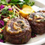 A plate of stuffed flank steak aka pinwheels