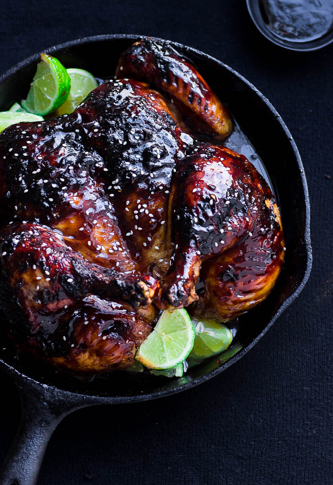 Delicious sticky pomegranate glazed roasted whole chicken. The pomegranate glaze can be used on chicken wings, chicken thighs, baked chicken breast and more!