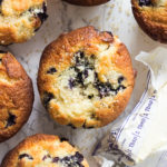 Whenever I make these jumbo bakery style blueberry corn muffins, my family and guests always ask for the recipe. These are not wimpy muffins at all. These muffins are full of blueberries with a slight crusty golden top and soft moist center. Just they way I like them. The combination of corn and blueberry is like no other. These muffins are quick to prepare and an easy treat that can be whipped up for a morning sweet or anytime of the day.