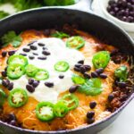 Cheesy tamale pie with cheesy cornbread topping plus more cheese on top of that! It's filled with black beans, more cheese and seasoned ground beef.  You can choose to infuse with chili powder mix , taco seasoning or your favorite enchilada sauce.  Top it off with sour cream, jalapeno and more black beans. This is perfect for busy weeknights!