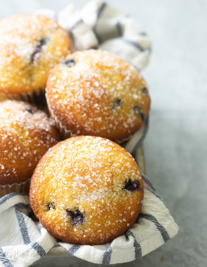 Blueberry corn muffins in a muffin basket