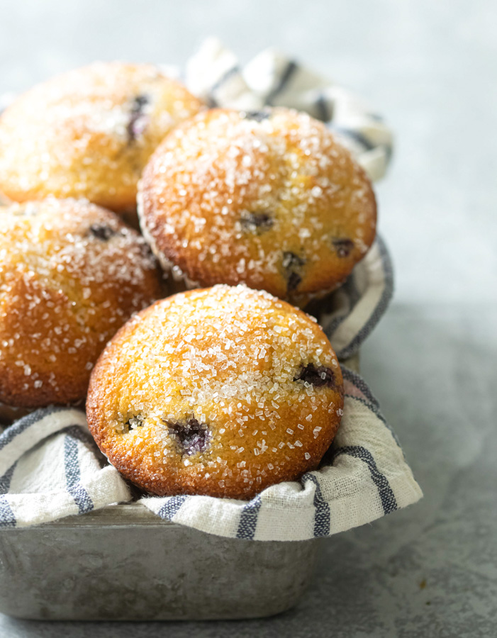 Jumbo blueberry corn muffins in a muffin basket