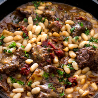 Braised Short Ribs With Black Eyed Peas and Cannellini Beans In A Chipotle Beef Gravy