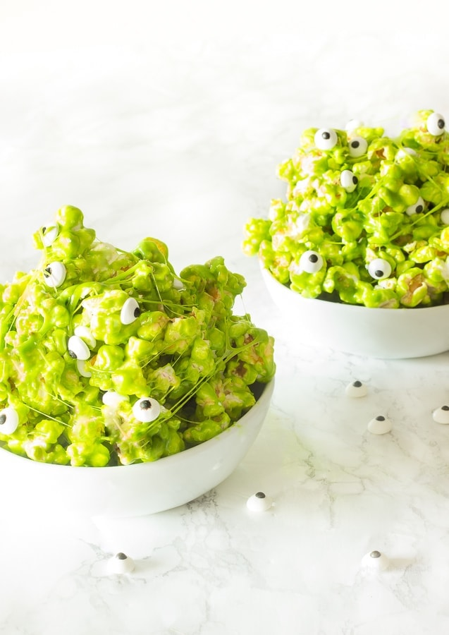 This quick and easy 6 ingredient green slime popcorn with candy eyeballs is a fun spooky Halloween treat! Perfect for kids or adult parties!