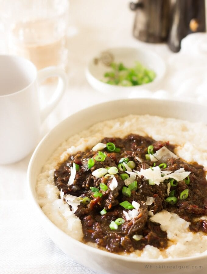 Grits and grillades prounouced (/ɡree-yahds/) is a popular southern New Orleans brunch/lunch usually served over grits. The meat, usually beef, (pork or veal is also used) is slow cooked in a rich and flavorful beef gravy made up of diced tomatoes, onions, red wine, beef broth, peppers, celery etc and served over cheesy Parmesan grits. Grits and grillades is perfect for Christmas brunch! So delicious!