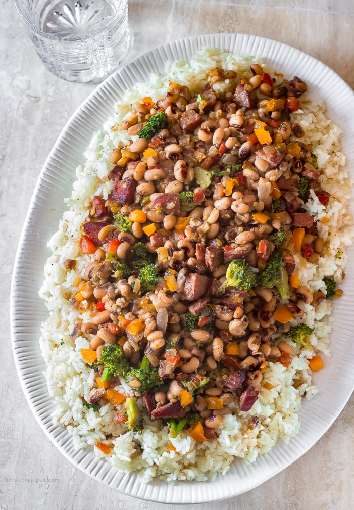 Traditional Hoppin John is a staple New Year's day dinner in the south. It's supposed to bring good luck and prosperity to anyone who eats it.  Classic Hoppin John is made with ham hocks or bacon and cooked in one pot.  My version uses, smoked sausages and healthy broccoli, frozen black-eyed peas and for kick, a couple pinches of crushed red peppers, It's quicker, more veggies and it's  still delicious. An easy hearty dish ready in about 30 minutes or less.