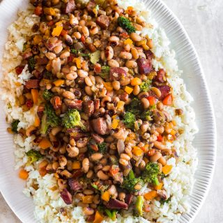 Traditional Hoppin John is thought to bring luck and prosperity. It's a staple New Year's day dinner in the south, especially in South Carolina. Classic Hoppin John is made with ham hocks or bacon and cooked in one pot. My quick version uses, smoked sausages and more vegetables like healthy broccoli, frozen black-eyed peas and for kick, a couple pinches of crushed red peppers. This is an easy hearty dish that's ready in 30 minutes or less.