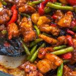 A pan of chicken green bean stir fry