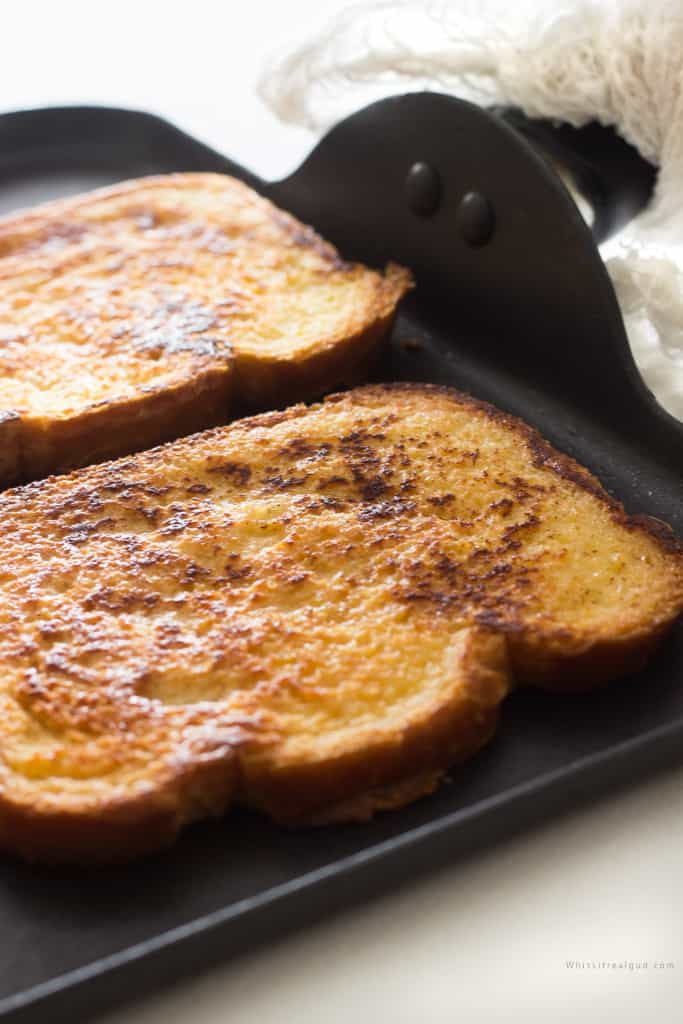 Picture of a griddle with french toast.
