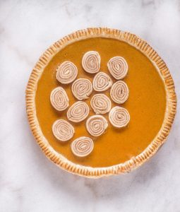 Sweet potato Pie topped with cinnamon roll slices