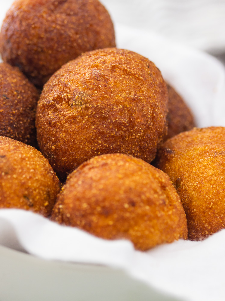 a bowl of golden brown hush puppies