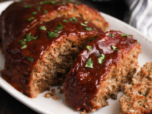 A photo of the Best Meatloaf Recipe with a peppery ketchup and brown sugar glaze on a serving platter