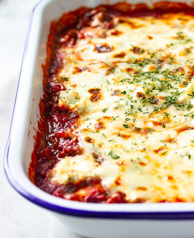 A plate of baked ravioli lasagna with meat sauce