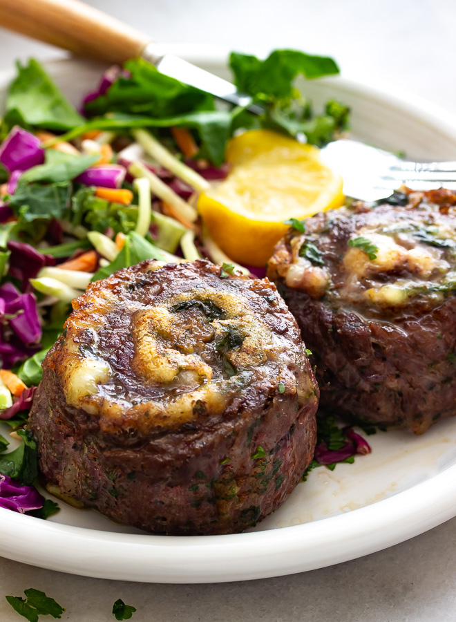 A plate of stuffed flank steak aka pinwheels