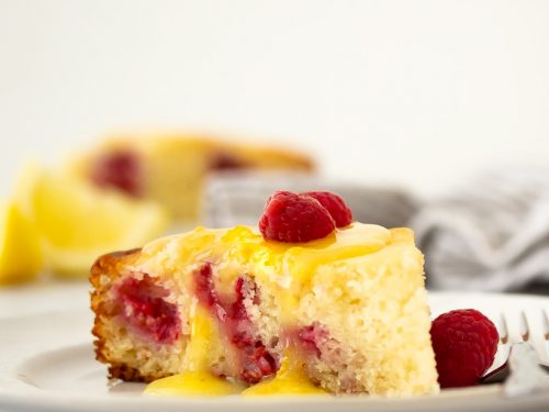A picture of ricotta raspberry cake with lemon curd glaze