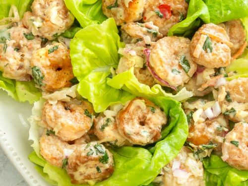A plate of shrimp lettuce wraps with sweet chili mayo