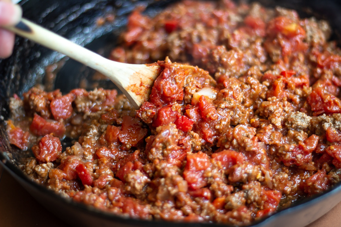 A picture of cooking the meat sauce in a skillet