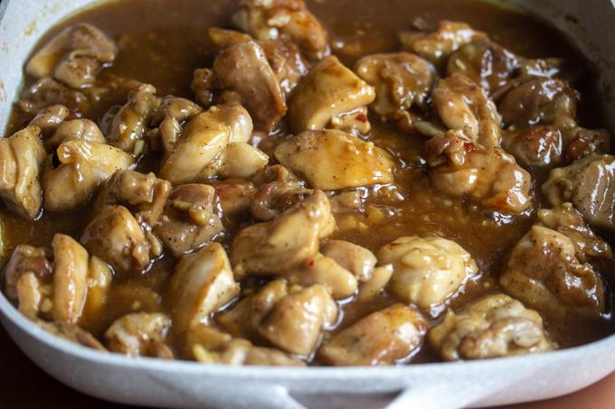 A skillet of caramel chicken