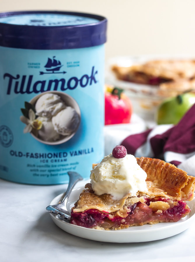 A picture of Tillamook old fashioned ice cream and a plate of cranberry apple pie topped with ice cream