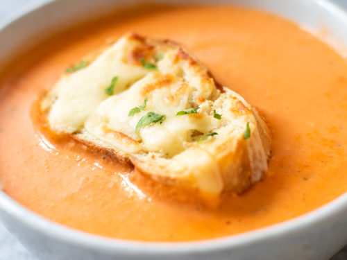 A small bowl of Cheesy Tomato Bisque