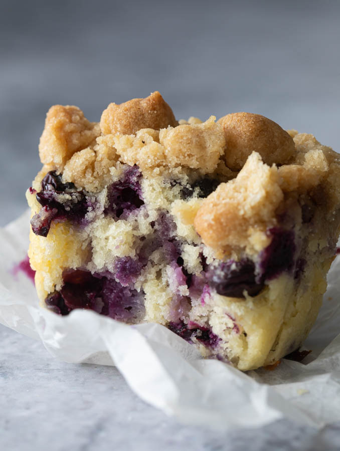 A closeup of blueberry muffins with buttermilk on a table