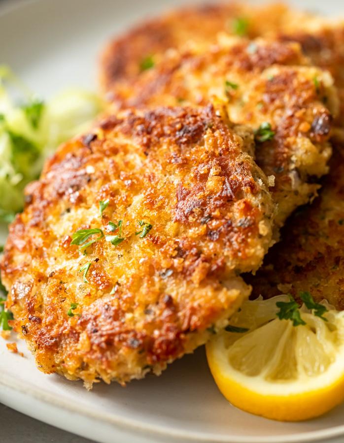 Crispy tuna patties with garlic lemon and herbs on a plate