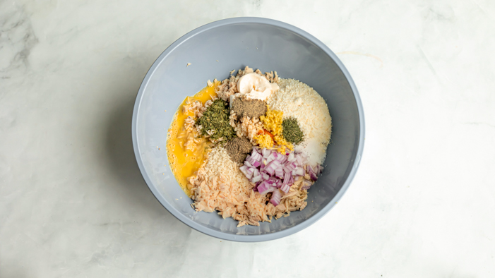 A bowl with tuna patties ingredients