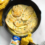 A picture of chicken in garlic cream sauce in a cast iron skillet