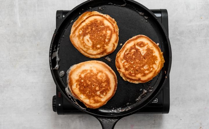 Sour cream pancakes on a skillet