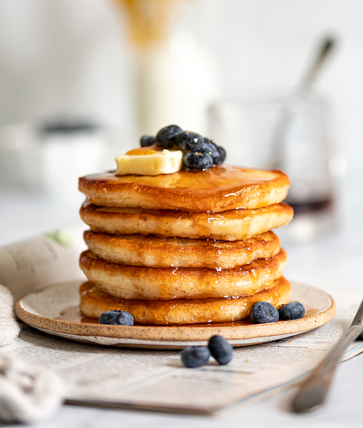 A plate of sour cream pancakes with crispy edges