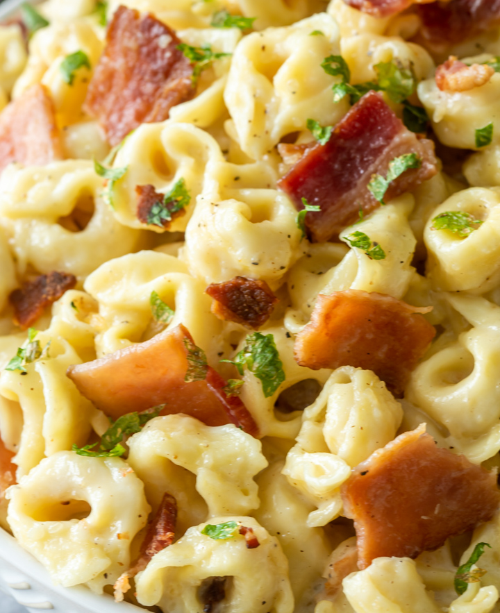 tortellini and bacon carbonara in a bowl