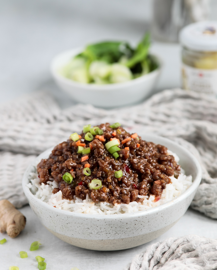 A bowl of Korean beef bowl inspired sweet chili ground beef topped with green onions