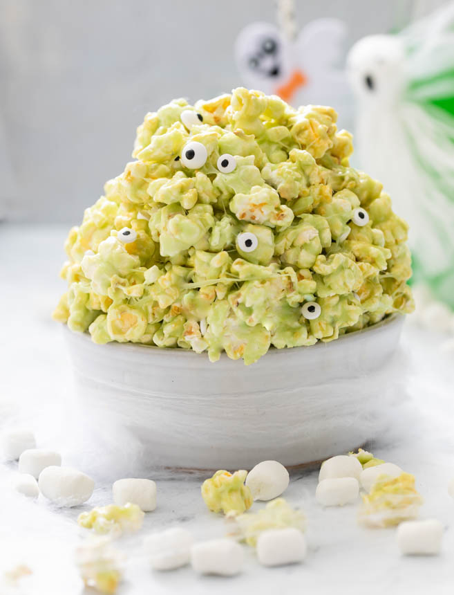 A picture of bowl of slime popcorn with candy eyeballs