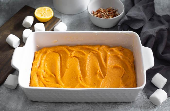 Sweet potato casserole in a white baking dish