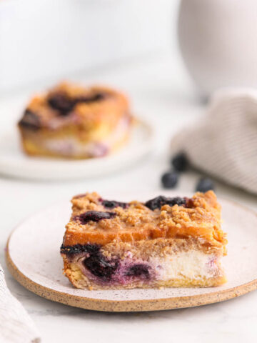 A plate of blueberry cream cheese french toast bake