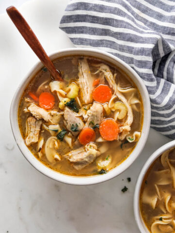 A picture of a bowl of homestyle chicken noodle soup